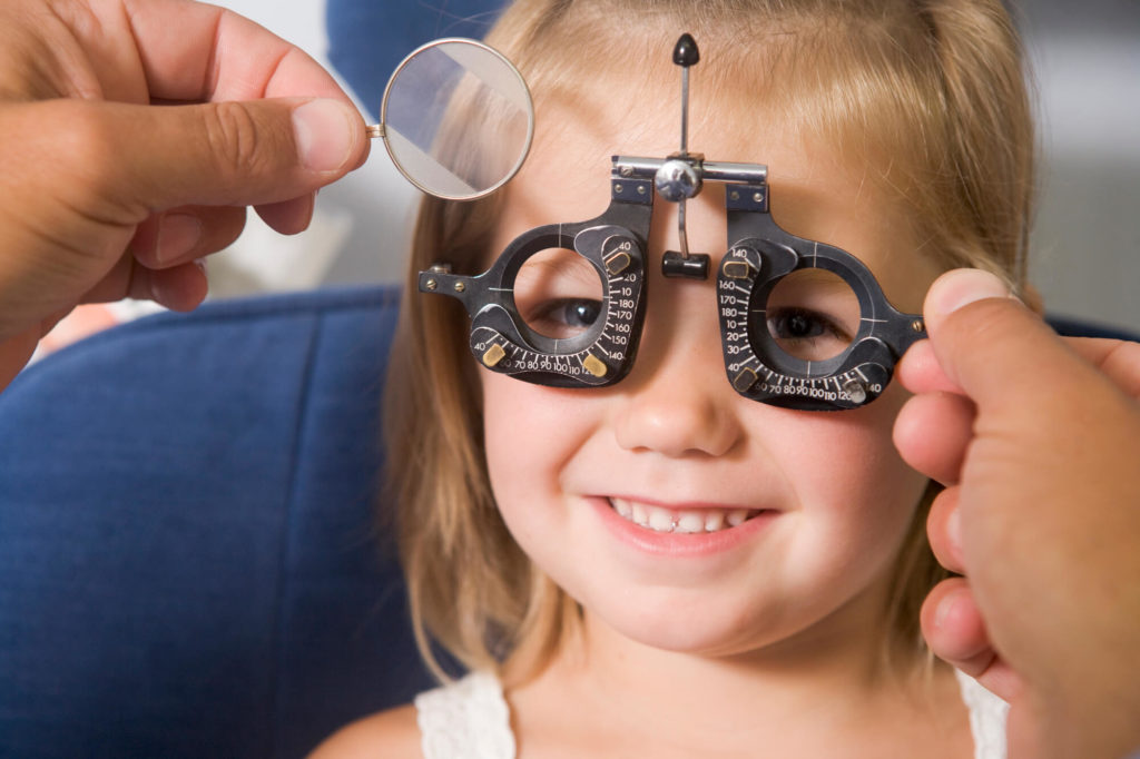 Does a child need an eye exam separately even if he/she has passed the vision test at school?
